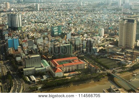 HO CHI MINH CITY, VIETNAM - JAN 16, 2016: Top view of Ho Chi Minh City from Bitexco Financial Tower, 68 floors (and 3 underground) area 100,000 square metr, is the third tallest building in Vietnam.