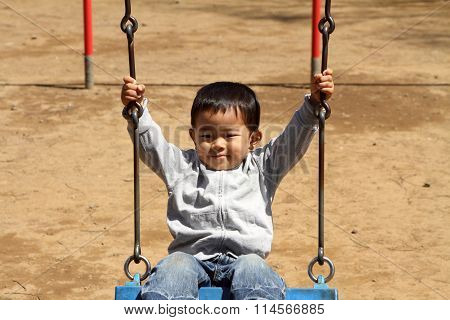 Japanese boy on the swing (2 years old)