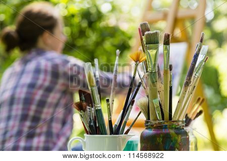 Woman Painting With Paint Brush