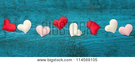 Red hearts on the blue boards