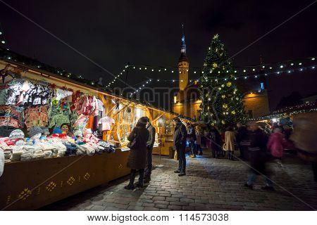 TALLINN, ESTONIA - DECEMBER 24: People visit Christmas Fair in old town  on December 24, 2015 in Tallinn, Estonia