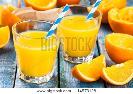 Freshly Squeezed Orange Juice In A Glass With Straws