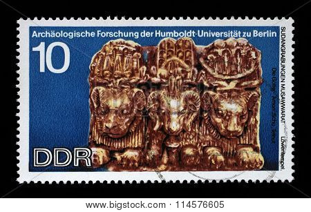 GDR - CIRCA 1970: A stamp printed in GDR shows Sudanese Archaeological Excavations by Humboldt University Expedition, The gods Amon Schu, carvings unearthed at Lions Temple, Musawwarat, circa 1970