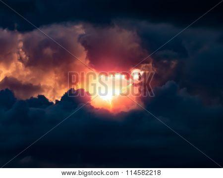 Sun Shining Through a Dark Sky