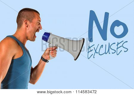 Angry male trainer yelling through megaphone against blue background