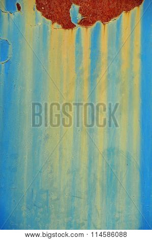 Blue background with rust and yellow drips. Acid color