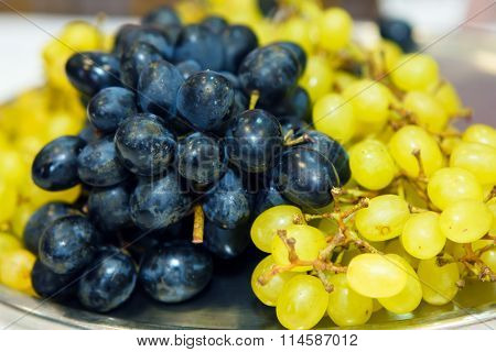 Yellow and black grapes. Healthy food fruit