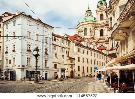 Historical Cityscape Of Praha With Old Houses And Stores