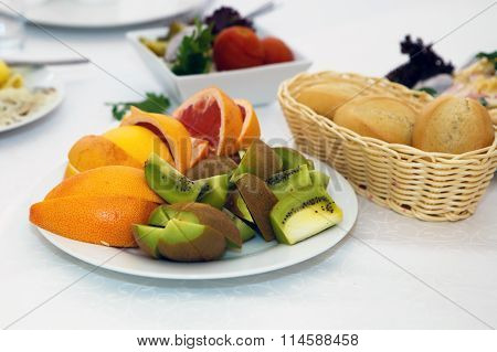 Dish of fruit. Kiwi and sliced oranges on a platter.