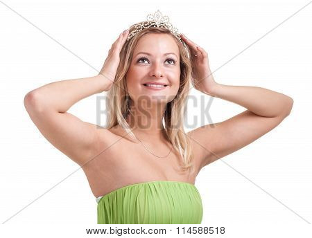 Portrait of lovely young woman with diadem. Isolated on white.