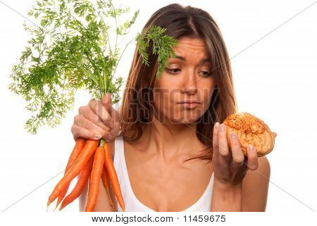 Woman Holding Bunch Of Fresh Carrots And Roll