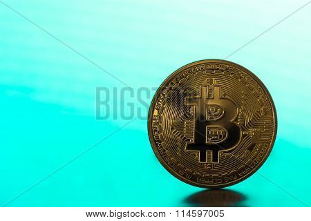 One Bitcoin On Green Backround