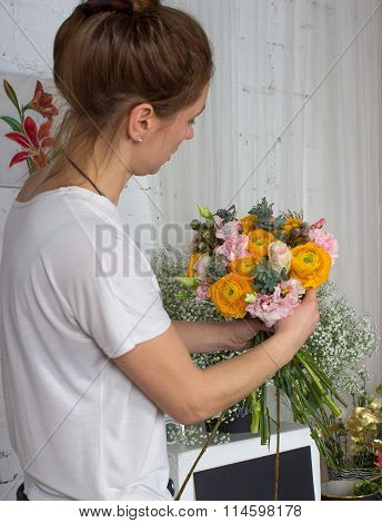 Florist Looking At The Bouquet Of Pastel Color Flowers