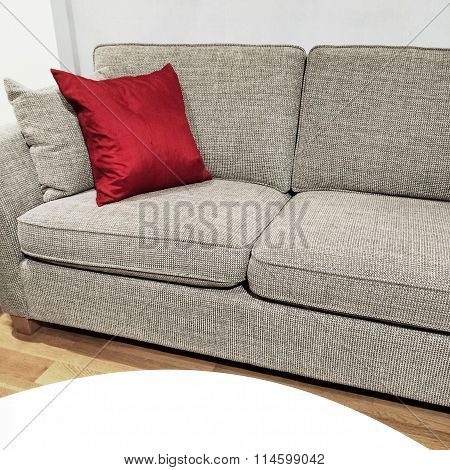 Detail Of A Living Room With Sofa And White Table