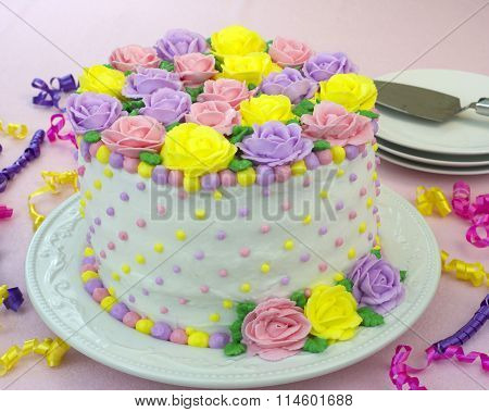 Pastel Rainbow Rose Cake on pink table cloth