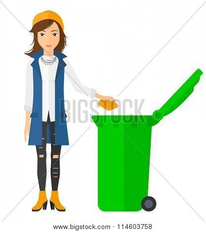 Woman throwing trash.