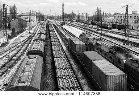 Freight Trains With Carriages At The Station. Top View. Black-and-white