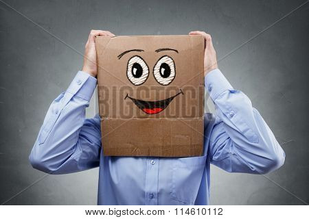 Businessman with cardboard box on his head with smiling expression concept for happiness, excitement, enthusiastic or success