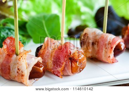 Macro Close Up Of Dates With Bacon Skewers.