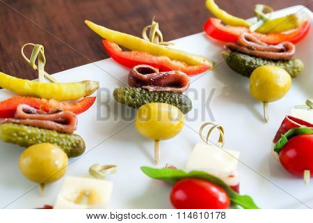 Mini Anchovy Appetizers Mounted On Skewers.