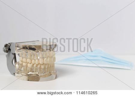 Dentures next to safety mask