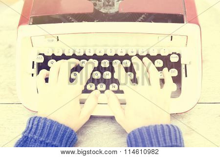 Top View Of A Woman Typing On A Typewriter, Vintage Photo Effect