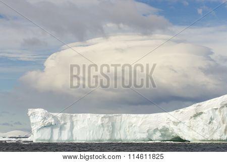Tabular Iceberg With Linticular Cloud, Antarctica