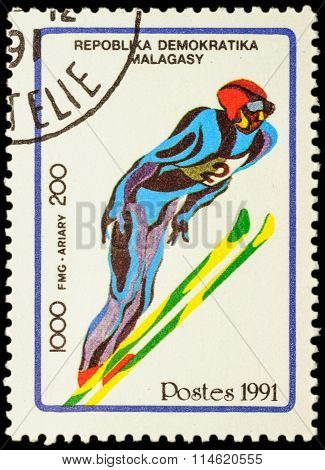 Colored Picture Of Flying Skier On Post Stamp
