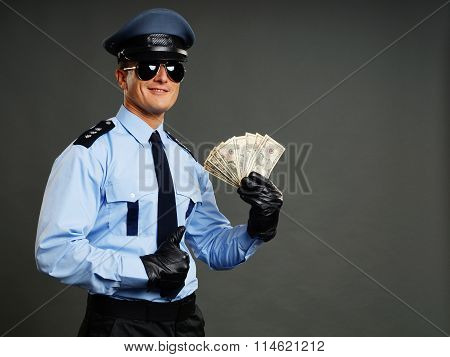 Policeman with money