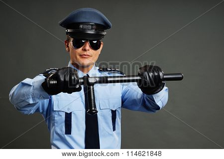 Policeman holds nightstick