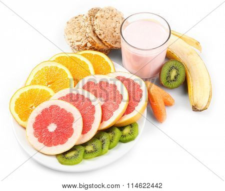Fruits and crispbread  isolated on white. Healthy eating concept.