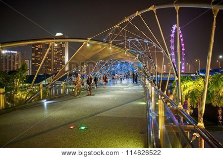 SINGAPORE - NOVEMBER 17, 2015: The Helix Bridge at night. The Helix Bridge is a pedestrian bridge linking Marina Centre with Marina South in the Marina Bay area in Singapore