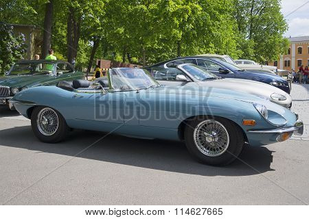 Blue Jaguar E-type Roadster (OTS) Series 2, a side view. Exhibition-parade of sports cars. Turku, Fi