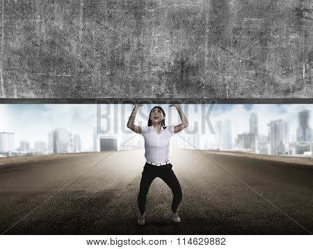 Asian Business Woman Lift Heavy Block
