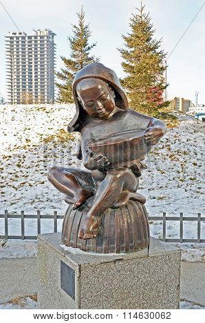 Ulaanbaatar, Mongolia - Dec, 03 2015:  The Sculpture Of Young Boy Reading The Book In Ulaanbaatar