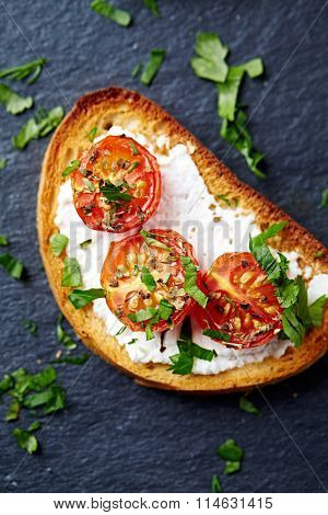 Crostini with cherry tomatoes and ricota
