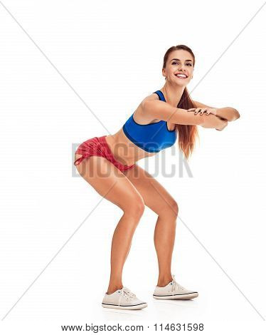 young woman with slim body. squatting