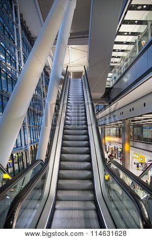 LONDON, UK - MARCH 28, 2015: Interior of Heathrow airport, Terminal 5. Escalators