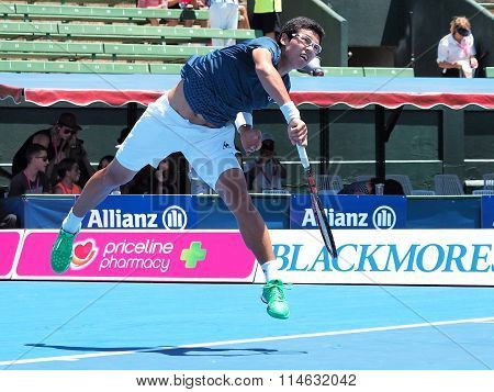 Hyeon Chung of South Korea follows through a serve