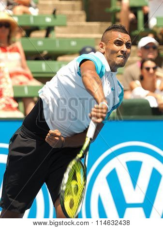 Nick Kyrgios of Australia serve follow through