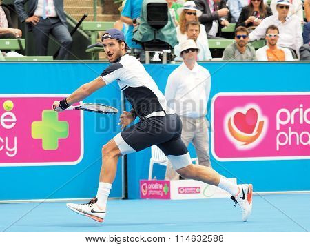 Feliciano Lopez of Spain runs for a backhand