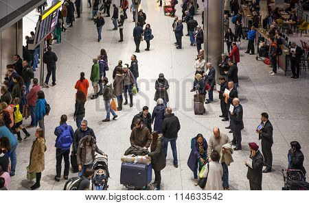 LONDON, UK - MARCH 28, 2015: Interior of arrival hall of Heathrow airport Terminal 5. Lots of people