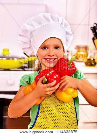 Child cooking at kitchen.