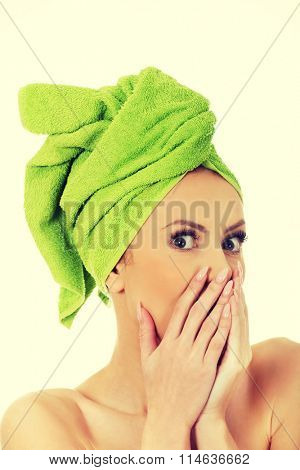 Shocked woman with turban towel.