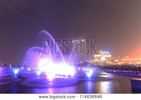 Nanchang, China - January 3, 2016: Dancing Water Fountain In Nanchang At Night With Thousands Of Tou