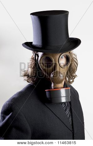 Man wearing a gas mask and a top hat