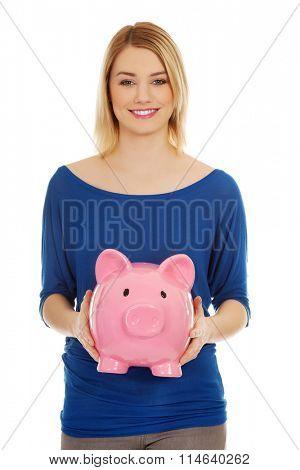 Happy woman with piggybank.