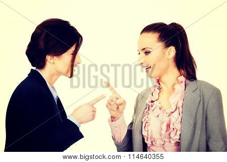 Angry businesswomans pointing on each other.