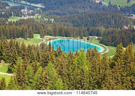Small alpine lake Heidisee in Lenzerheide, Switzerland