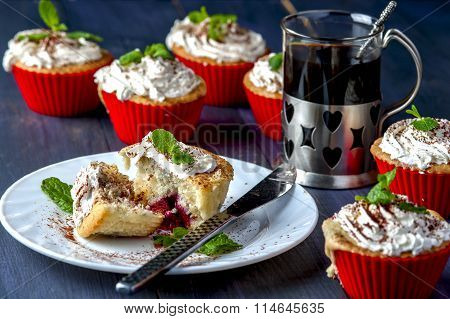 Muffin with cherry and pineapple on white plate
